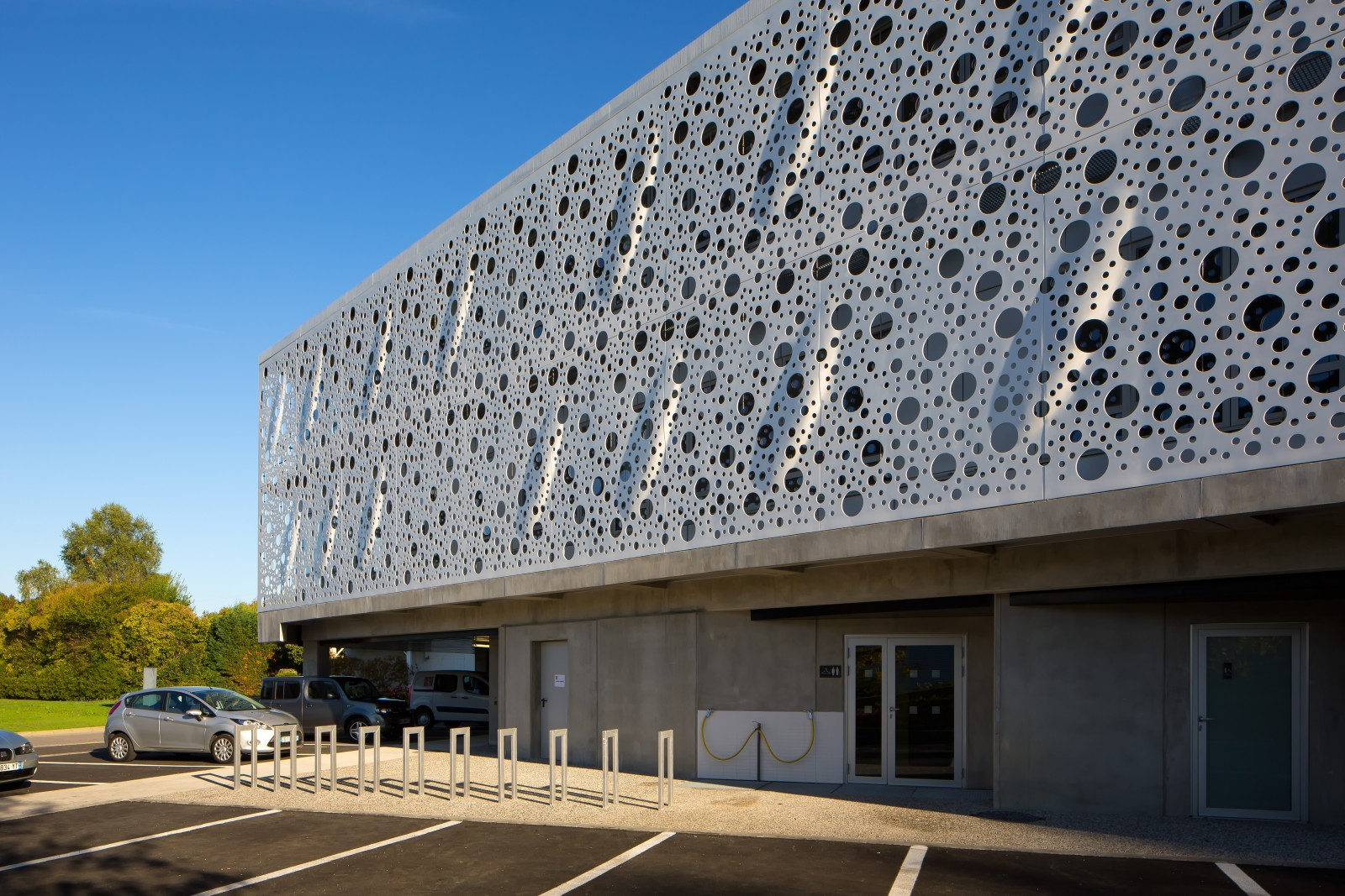 Exterior: perforated panels and floating by Gilles Bouchez